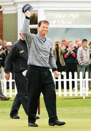 Tom Watson salutes the crowd after winning the Senior British Open. Watson won with a score of even par Sunday in Gullane, Scotland. Story on page 2B.