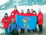 Jayhawks head south for an exploration of Antarctica in January 2007. John Kernan, front row, was the expedition leader. Also pictured, from left, are Roger and Mary Ann Wehrs, Reed Miller and Jill Simpson Miller, Barbara Glanz, Paula Nauers, and Barb and Bob Kleist.