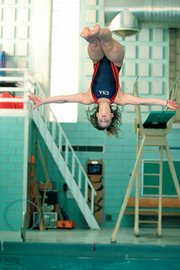 Jayhawk diving club member logan kline captured two national championships at the AAU junior national championships July 24-29 in Orlando, Fla. Kline finished first in both the preliminary and final rounds of the one- and three-meter dives. She will travel Aug. 6-11 to the U.S. Diving junior nationals in Mission Viejo, Calif.