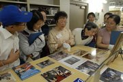 Flora Hsu, center, a volunteer at the Dole Institute of Politics, leads a tour of the institute in Mandarin Chinese during the institute's bilingual tour day June 16. Since opening in 2004, the institute has been host to bipartisan speakers and innovative programming.