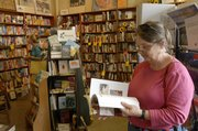 Mary Wheeler, right, of Prairie Village, shops with friends at the Raven Bookstore, 8 E. Seventh St. Co-owners Mary Lou Wright and Pat Kehde plan to sell the shop to at least three prospective buyers, who don't plan major changes for the downtown store that celebrates its 20th anniversary Sept. 8.