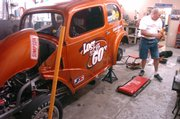 "Rod Urish works on his ""Lost in the 60&squot;s"" drag racer."