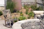 Mike Gerken has accentuated his lawn by creating stone pathways and structures.