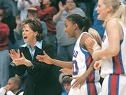 KU's women's team lost 20 games last season, but coach Bonnie Henrickson, left, insists the Jayhawks were better than their record.