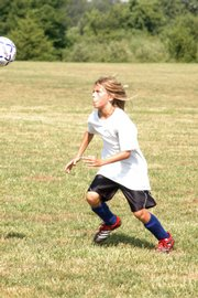 Alex Houston practices during the Kaw Valley Soccer Associations preseason camp Monday at YSI.