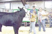 Tyler Kapelle, 12, is pictured with the grand champion market steer and its buyers, Brad Chindamo from Central National Bank, behind Tyler at left, and Scott Zaremba from Zarco 66, at right. Tyler showed the steer on Sunday at the Douglas County Fair.