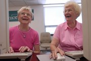 Lois Adriance,  left, and Dorothy Resco laugh during a lesson on navigating the World Wide Web in a computer class at the Lawrence Senior Center, 745 Vt. Douglas County Senior Services offers many programs and events for retired people in the community.