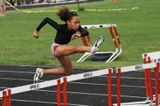 Alexa Harmon-Thomas, 11, runs the 80-meter hurdles at the AAU Junior Olympics last week in Knoxville, Tenn. Harmon-Thomas broke the national record in her age group in the event.