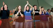 Kansas University students cheer as headlining act The Faint takes the stage at KU's Day On the Hill.