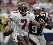 Tampa Bay Buccanears quarterback Jeff Garcia (7) is chased from the pocket by New England Patriots' Jarvis Green during the first quarter of the Buccanears' 13-10 preseason victory Friday night.
