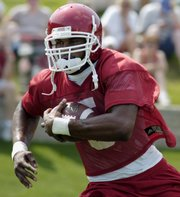 Arkansas tailback Darren McFadden goes through drills. McFadden was runner-up in the 2006 Heisman voting.