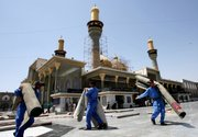 Workers roll up carpets used by thousands of pilgrims Friday at the holy shrine of Imam Moussa al-Kadhim in the Kazimiyah neighborhood of Baghdad. Shiite pilgrims made their annual march Thursday to commemorate the eighth-century death of Imam Moussa al-Kadhim, a key Shiite saint.