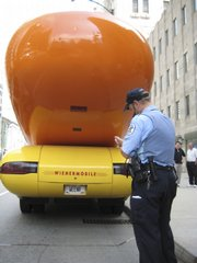 A Chicago police officer tickets the Oscar Meyer Wienermobile.