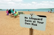 Bloomington Beach at Clinton Lake is a popular place to cool off in the summer, though signs remind swimmers that it is not always safe. Last week a Lawrence man drowned in a location off-limits to swimmers because of busy boat traffic in the area. The U.S. Army Corps of Engineers says tracking hazards in the 7,000-acre lake can be difficult.