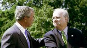 President Bush looks toward outgoing White House Deputy Chief of Staff Karl Rove after speaking Monday on the South Lawn of the White House in Washington. Rove, Bush's close friend and chief political strategist, plans to leave the White House at the end of August, joining a lengthening line of senior officials heading for the exits in the final 1 1/2 years of the administration.