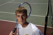 Scott Elwell, a Lawrence High graduate and former Iowa University tennis player, is the coach for the new Seabury Academy girls tennis team.