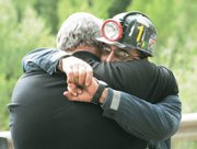 Mine safety manager and member of the rescue team miner Bodee Allred gives Sheriff Lamar Guymon a hug after an update on the rescue efforts for six trapped coal miners during a news conference Wednesday at the entrance to the Crandall Canyon Mine in near Huntington, Utah.  Allred's cousin, Kerry Allred, is one of the trapped miners.