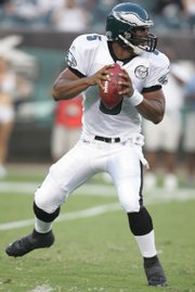 Philadelphia quarterback Donovan McNabb sets to throw against Carolina. The Eagles defeated the Panthers, 27-10, Friday in Philadelphia.