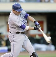 Kansas City's Billy Butler connects for an RBI double off Oakland's Dan Meyer. The Royals won, 9-2, Friday in Oakland, Calif.