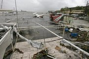 A boat sinks as it takes on water amid debris  Friday, after Hurricane Dean, a Category 4 storm, hit Martinique, in Fort de France.