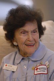 Margaret Shirk has been a Douglas County Red Cross blood drive volunteer since 1966. Monday she volunteered at First Christian Church where friends and co-workers helped celebrate her 90th birthday.