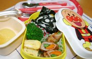 "Chizuru Saruta prepared this lunch for her 4-year-old daughter, Aina, at their home in Yokohama, south of Tokyo. The lunch box featuring popular Japanese comic book character Anpanman is filled with an ""onigiri"" rice ball topped with a sheet of ""nori"" seaweed, an omelet, chicken rolls with carrot and string beans, broccoli and a fruit jelly."