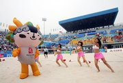 The 2008 Olympics mascot dances with cheerleaders between matches at Sunday's FIVP Beach Volleyball Women's Challenger in Beijing. China hopes its regimented training schools will give it an edge in next summer's medal race with the United States.