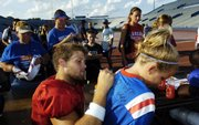 Kansas quarterback Todd Reesing autographs the jersey of 9-year-old Drew Lawrence, Overland Park, during fan appreciation day Wednesday at Memorial Stadium.