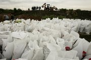 Sandbags sit below a levy Thursday in Ecatepec, Mexico, after a drainage canal overflowed. Rain water from Hurricane Dean helped push the waters of a major Mexico City sewage canal into an adjacent neighborhood as the storm passed nearby.