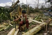 A boy sits near his destroyed house after the passing of Hurricane Dean in Limones, Mexico, in the Yucatan peninsula. Dean, which crashed into the Caribbean coast of Mexico on Tuesday as the strongest hurricane to hit land in the Atlantic region since 1988, made a second, and much weaker, landfall Wednesday in the Veracruz region.