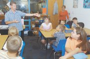 Eudora West Elementary School reading teacher Chris Lounsbury leads a third-grade class in a lesson on punctuation. Lounsbury's room was built over the summer from space in West's library as a way to deal with the growing student population.