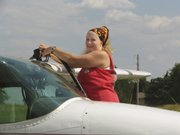 In this undated photo provided by AirCapital DropZone.com, pilot Lori Love is shown refueling a plane. Love, a Wichita native, was last heard from an hour after taking off from Accra, Ghana, on 