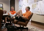 BP Capital founder T. Boone Pickens, right, and Oklahoma State athletic director Mike Holder laugh as they respond to a reporter's question. Pickens is the billionaire alumnus who donated $165 million to renovate the football stadium and create an athletic village at Oklahoma State.