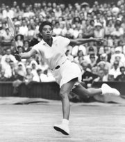 Althea Gibson prepares to volley against Britain's Ann Haydon during the Wimbledon women's singles semifinal tennis match in Wimbledon, England, in this July 3, 1958 file photo.