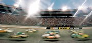 Cars race through a turn on the new surface at Bristol Motor Speedway during the Busch Series Food City 250. Kasey Kahne won the race Friday in Bristol, Tenn.