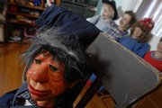 Lawrence attorney and ventriloquist Bonita Yoder owns eight traditional ventriloquial figures, including B. J. Dharma pictured above, and dozens of soft puppets including hand puppets.