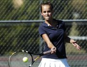 Seabury Academy seventh-grader Padget Sutherland returns a volley while playing doubles with her sister, senior Brooke Sutherland. The Seahawks played Lawrence High's junior varsity on Friday at Lawrence Tennis Center.