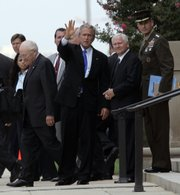 President Bush leaves the Pentagon on Friday with, from left, Vice President Dick Cheney, Defense Secretary Robert Gates and outgoing Joint Chiefs Chairman Gen. Peter Pace. Military chiefs conveyed to Bush their concern about a growing strain on troops and their families from long and repeated combat tours. See story, page 3A.