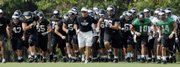 Missouri coach Gary Pinkel leads his team in a sprint down the field at the beginning of the squad's first practice of the season in this file photo from Aug. 4 in Columbia, Mo. MU will open its season against Illinois today in St. Louis.