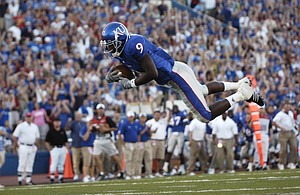 In the first game of the season, punt returner Raimond Pendleton dives headlong into the endzone after running back a punt for a touchdown during the first half against Central Michigan on Saturday, Sept. 1, 2007 at Memorial Stadium.