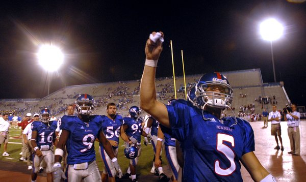 Kansas quarterback Todd Reesing looks to toss his wristbands into the crowd of young Jayhawk faithfuls following their 52-7 win over the Central Michigan Chippewas, Saturday, Sept. 1, 2007 at Memorial Stadium.