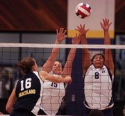 Haskell's Holly Tanner, center, and Takara Bighorse, right, jump to block a spike from Graceland's Jennifer Stone. Graceland won, 3-0, Tuesday at Coffin Sports Complex.
