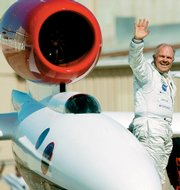 GlobalFlyer pilot Steve Fossett waves to the crowd in this March 3, 2005, file photo, at the Salina Municipal Airport. Fossett flew out of Salina on the world's first solo trip around the globe without refueling. A small plane carrying Fossett has been missing since Monday night, federal officials said Tuesday.
