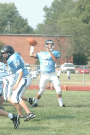 West quarterback Aaron Rosenstengle looks to pass during the Warhawks' game against Shawnee Mission South on Tuesday at West Junior High.