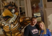 Kansas University graduates Christopher Veit and Jessica Virtue, former Big Jay and Baby Jay mascots, will be getting married in October. They were photographed earlier this month in front of the John Brown Jayhawk, one of the Jayhawks On Parade by sculptor Jim Brothers.