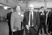 Linda Zarda Cook, an executive director of Royal Dutch Shell, visits with Kansas University Chancellor Robert Hemenway during the KU School of Engineering Distinguished Engineering Service Award banquet in May. Cook, a 1980 petroleum engineering alumna who appears on Forbes' 100 most powerful women list, received the school's award for 2007.