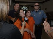 Hit-and-run suspects Ramona I. Morgan, left, and daughter Sabrina J. Morgan are escorted by Osage County Sheriff's officers into the Osage County Courthouse Wednesday, Sept. 12, 2007 for their first court appearance. The appearance came a day after the accident on US Highway 59 four miles south of Lawrence which left two men dead Ramona I. Morgan was ordered held on a $2 million bond and Sabrina J. Morgan ordered held on a $1 million bond at the request of Osage County Attorney Brandon Jones.