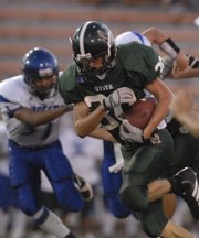Free State senior defensive back Jason Sneegas returns a fumble for a touchdown.