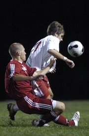 LHS sophomore Drake DeBiasse, right, battles Olathe North junior Max Doby for possession Thursday, Sept. 13, 2007 during the soccer match at YSI fields.