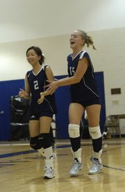 Seabury Academy sophomore Jasmine Tse, left, and junior Bria Phipps come off the court in high spirits after winning the first game against Flint Hills. Flint Hills rallied to beat the Seahawks on Thursday at Seabury.